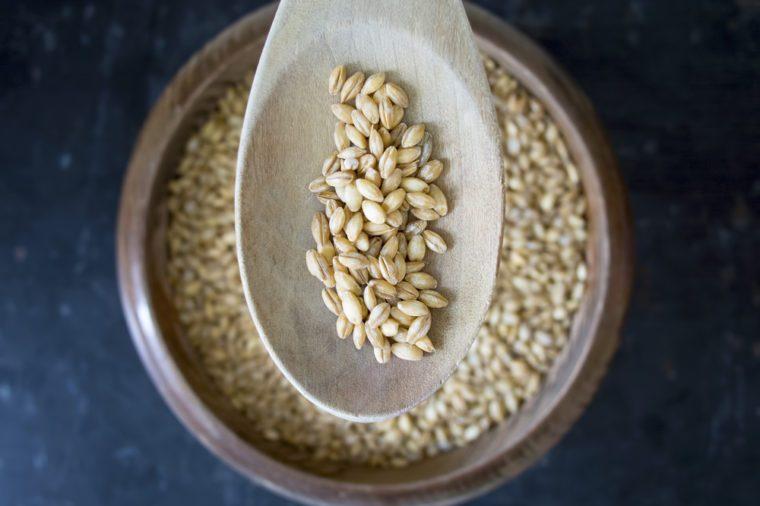 Barley on dark rustic background overhead shot