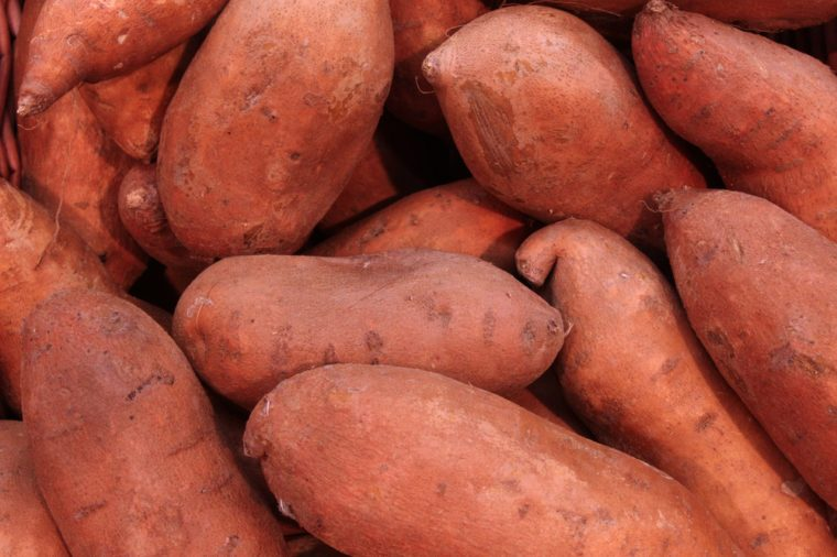 pile of sweet potatoes at a farmers market