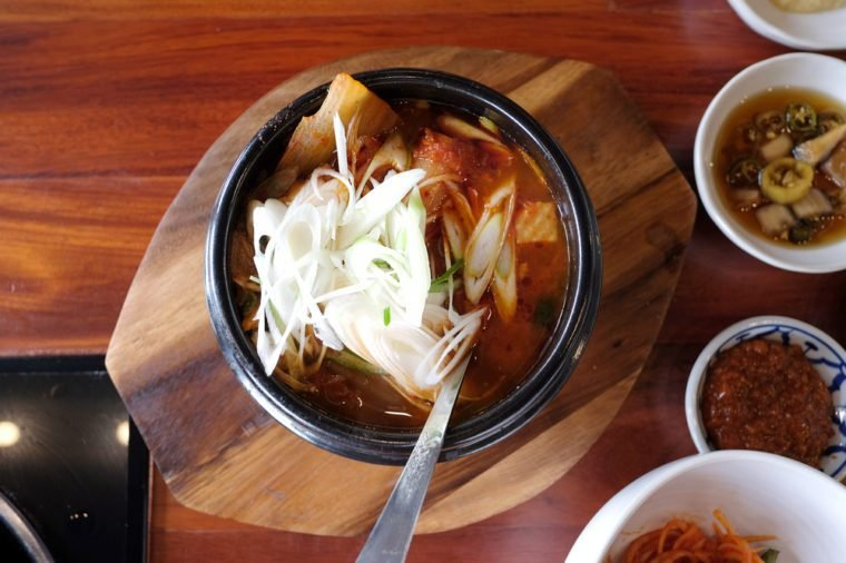 Kimchi jjigae is a soup, or stew ike Korean dish, made with kimchi and other ingredients, such as scallions, onions, diced tofu, pork, and seafood.