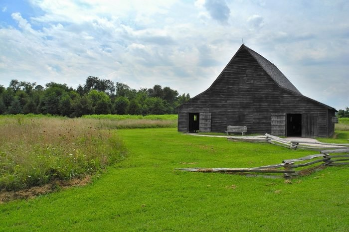 One of the old buildings in Historic St. Mary's City, which was Maryland's (United States of America) first capital city. Time stopped here in 17th century. Green grass and wooden building. Fields.