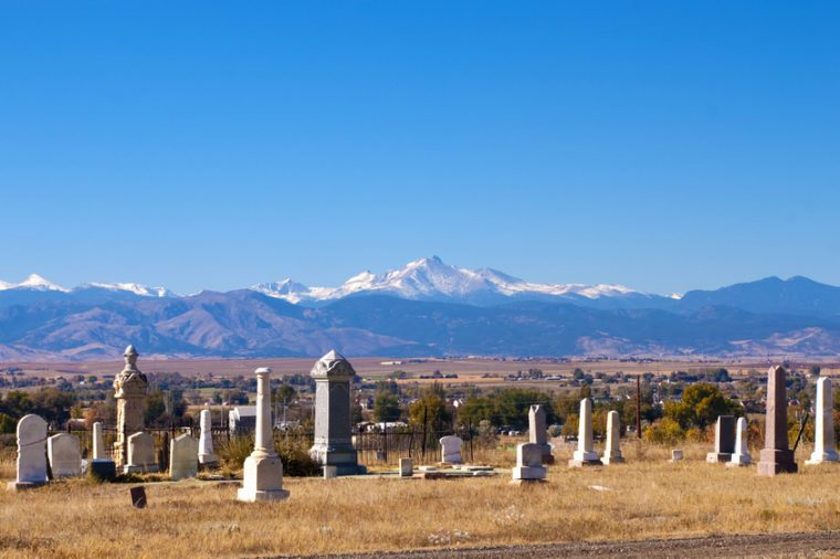 Small, old graveyard with view of Rocky Mountains and a small Colorado town