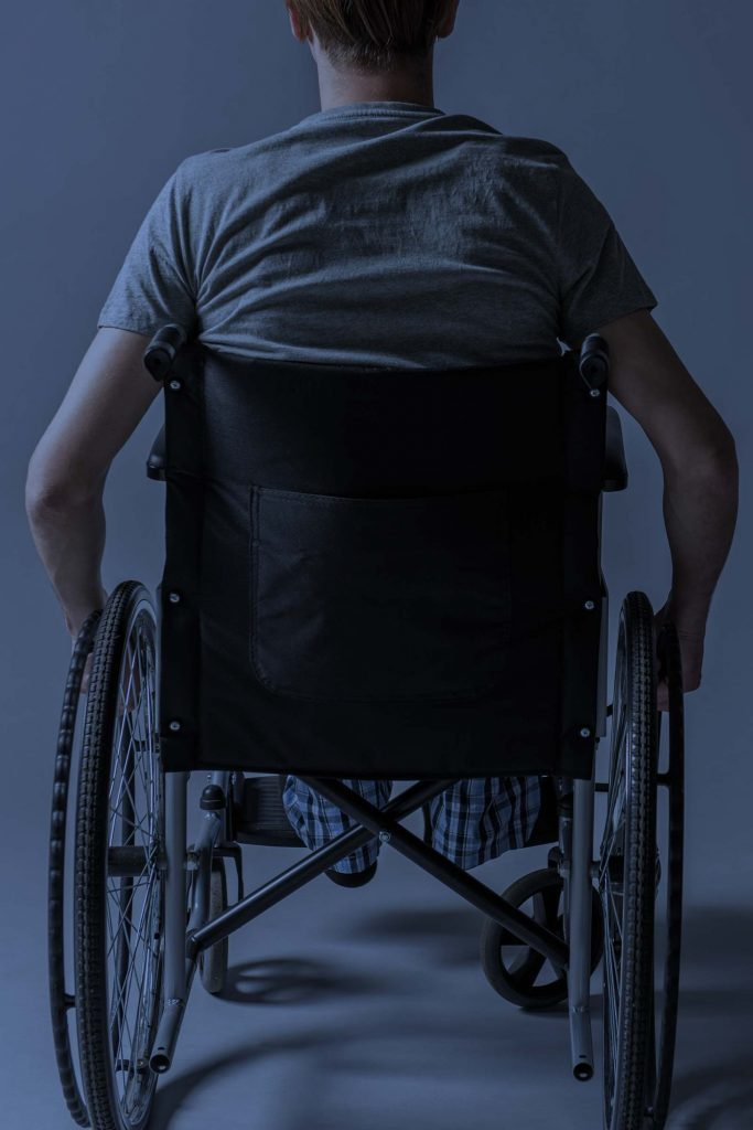 Man in wheelchair from behind