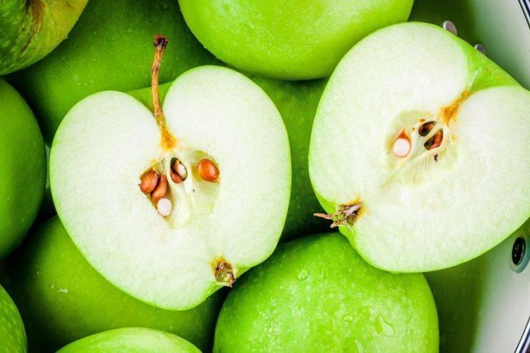 organic green juicy apples in colander closeup