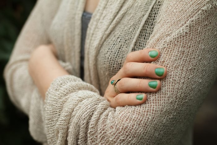 Fold One's Arms. Woman cross arms in wool jacket.