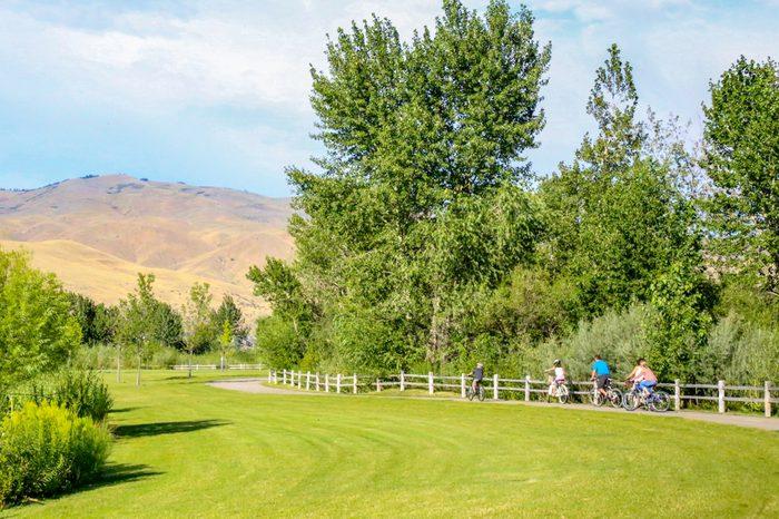 Family biking along the greenbelt in Boise, Idaho