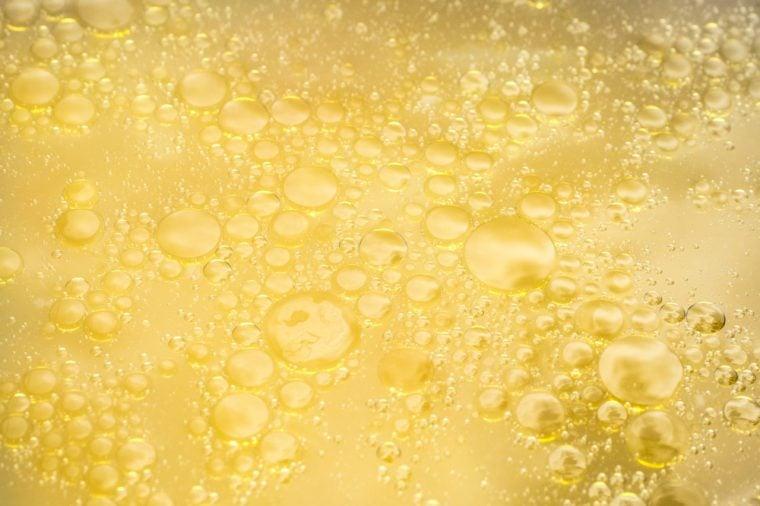 Fat oily broth, bouillon, soup close-up