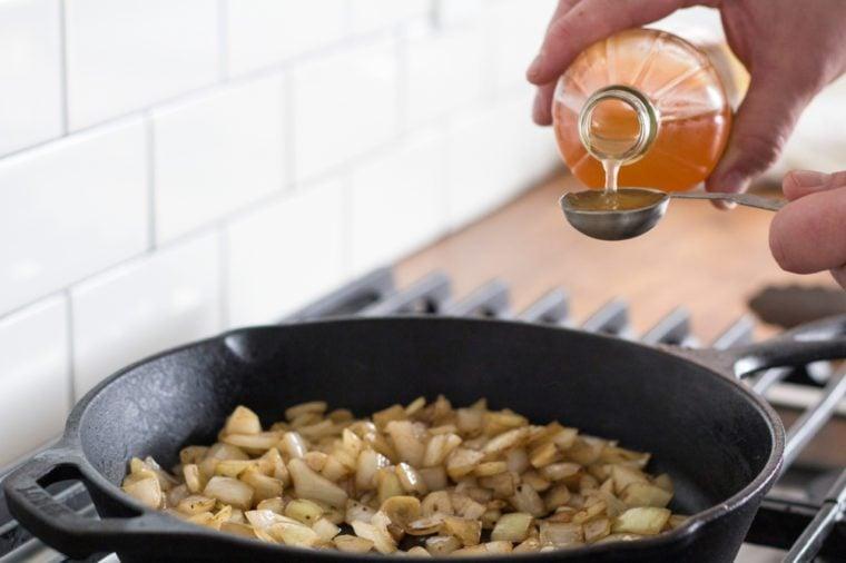 Measuring apple cider vinegar for caramelized onions