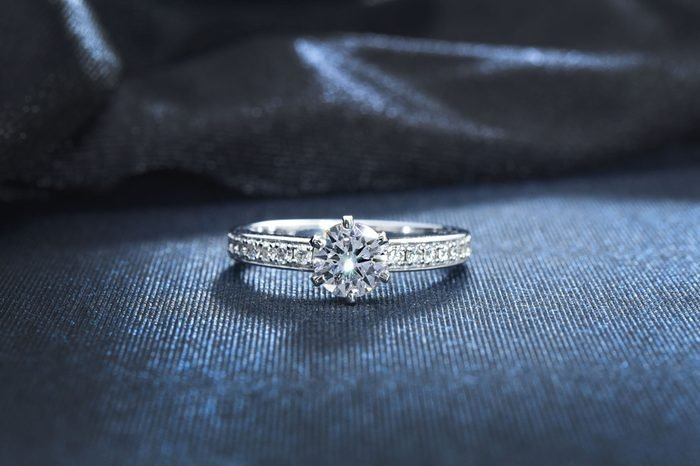 Diamond ring, engagement wedding ring on dark background.