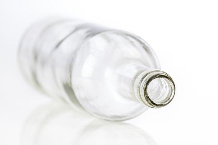 Empty glass bottle isolated on white background