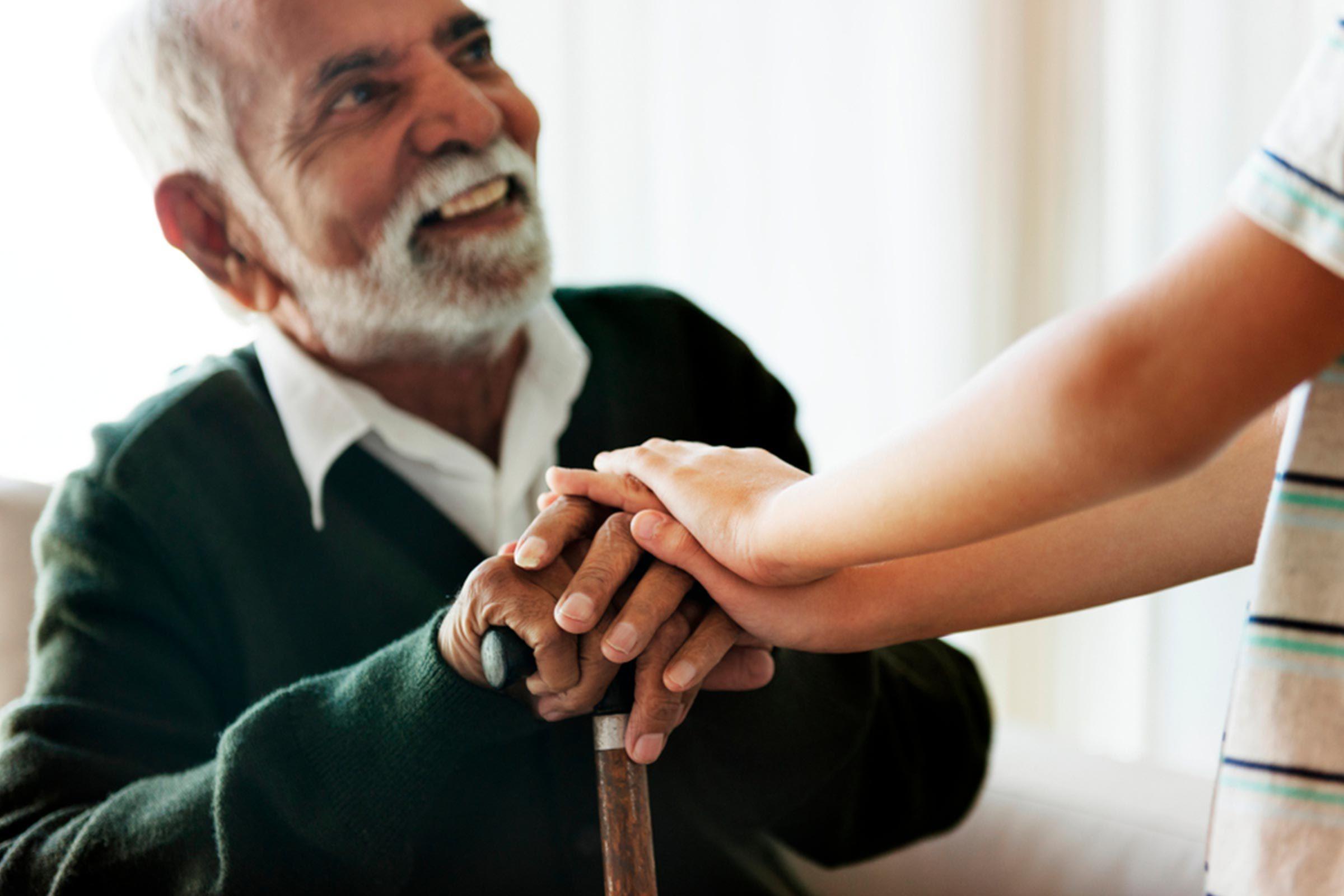 Grandson Holding grandpa's hand