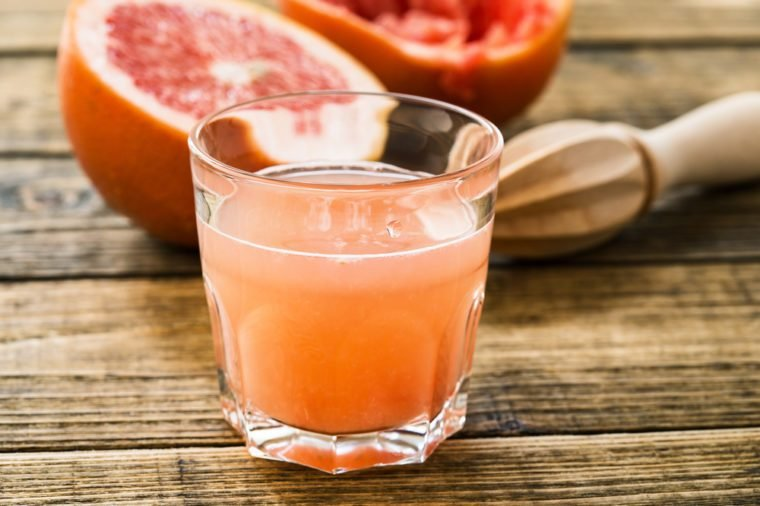 Glass of fresh organic pink grapefruit juice ready to drink