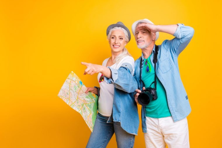 Relationship together jeans casual stylish outfit concept. Look far away attention interesting thing! Photo portrait of two excited carefree cheerful joyful partners on honeymoon isolated background
