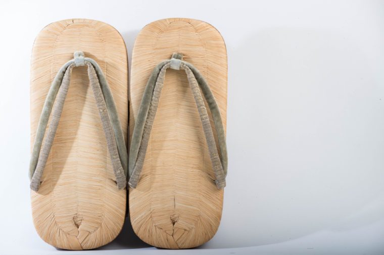 Geta sandal as one of the most popular japanese classic shoe under white background in studio