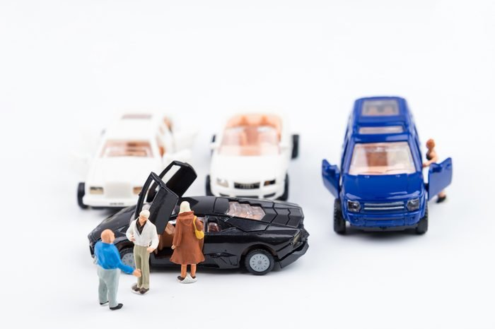 Nonthaburi, Thailand - August, 18, 2017 : Miniature man tiny toys agreed to buy a new car in the car showroom.Happy life background.selective focus