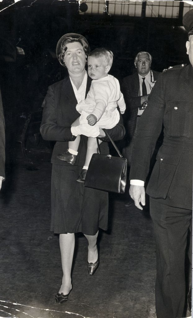 Prince Edward 17 Months Old Youngest Son Of Queen Elizabeth Ii Being Carried By His Nanny At Kings Cross Station......