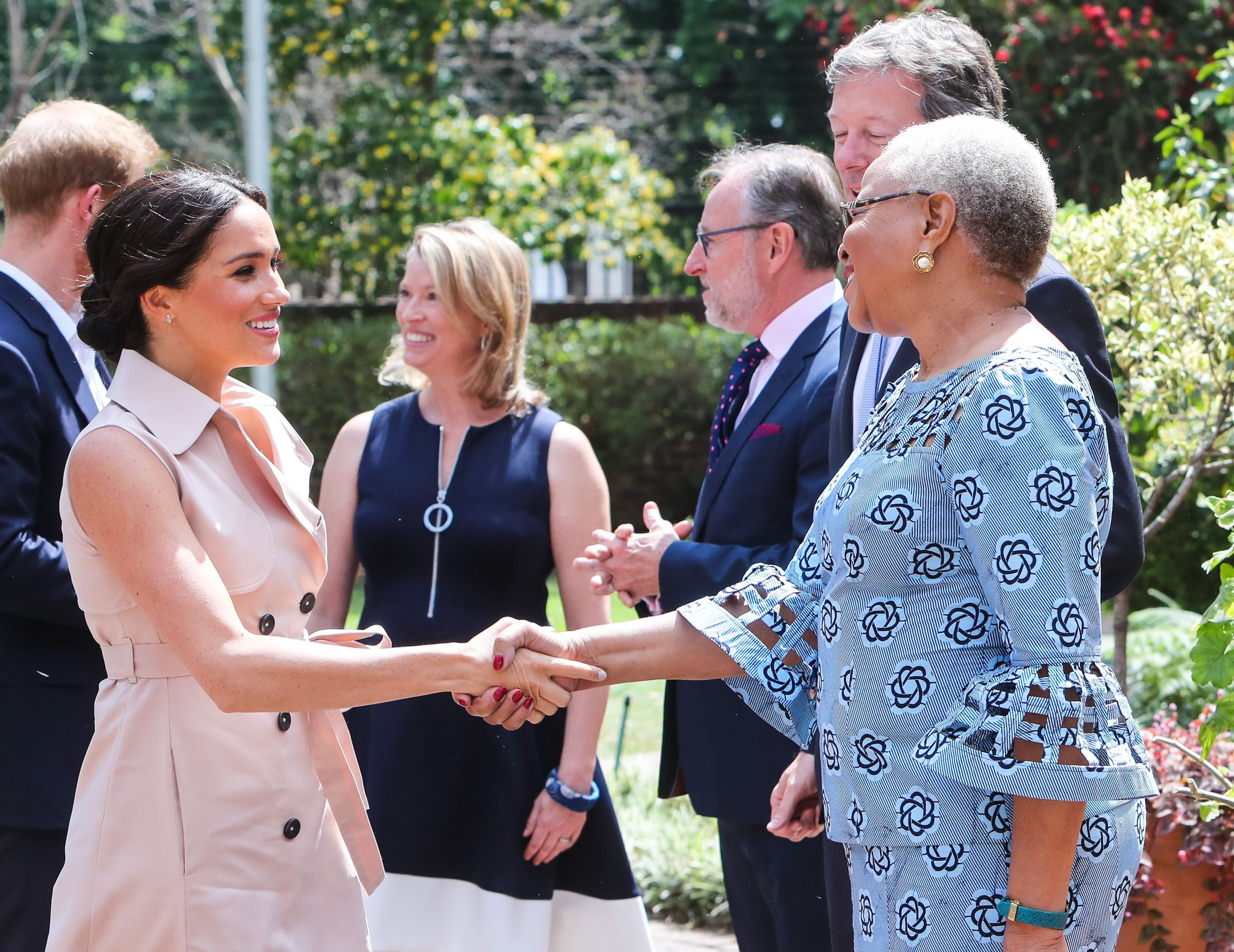 Mandatory Credit: Photo by Shutterstock (10434241q)<br /> Meghan Duchess of Sussex and Prince Harry meet with Graca Machel, widow of Nelson Mandela at the High Commissioner's residence in Johannesburg, South Africa.<br /> Prince Harry and Meghan Duchess of Sussex visit to Africa - 02 Oct 2019<br /> The Duke and Duchess of Sussex meet with Graca Machel, widow of Nelson Mandela at the High Commissioner's residence in Johannesburg, South Africa.