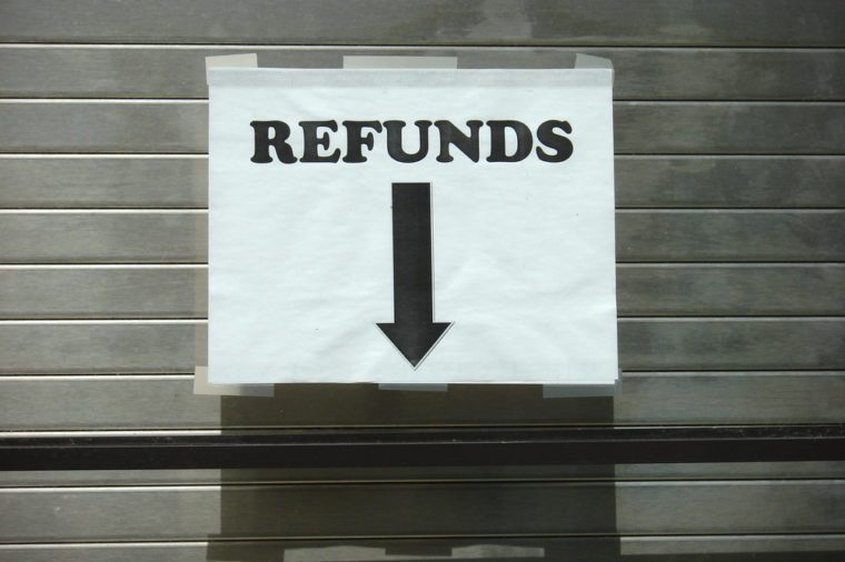 refund sign with arrow taped on window