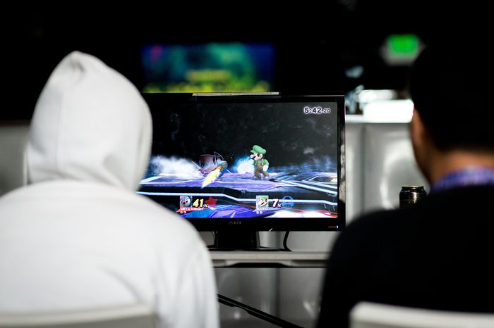SACRAMENTO - FEBRUARY 18: Two unidentified eSports athletes playing in a Super Smash Bros. match at Extra Life fighting game tournament to benefit Children's Miracle Network Hospitals on Feb 18, 2017.