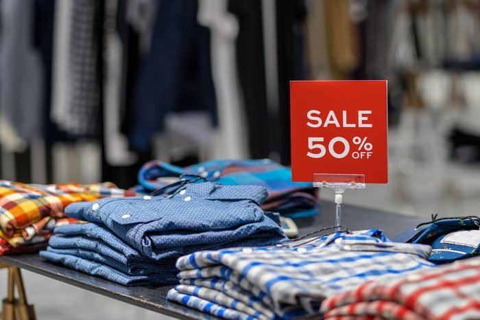 sale 50% off mock up advertise display frame setting over the clothes line in the shopping department store for shopping, business fashion and advertisement concept