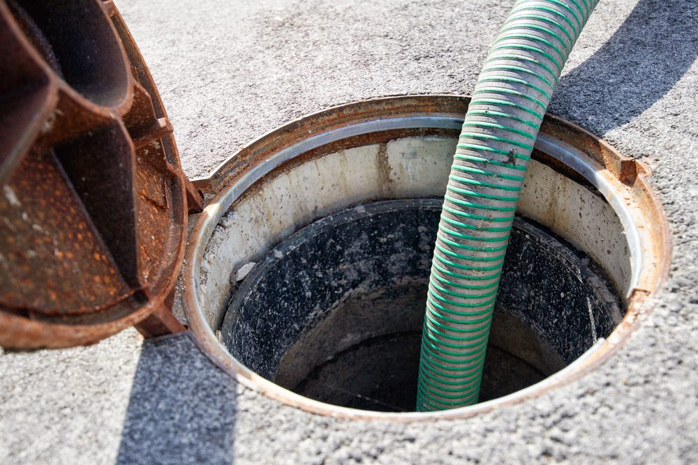 Emptying septic tank, cleaning the sewers. Septic cleaning and sewage removal. Emptying household septic tank. Cleaning sludge from septic system.