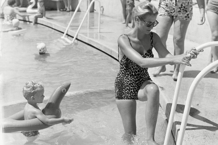 Princess Grace Of Monaco With Her Son Prince Albert At The Swimming Pool On Monaco Beach In 1960. Grace Kelly