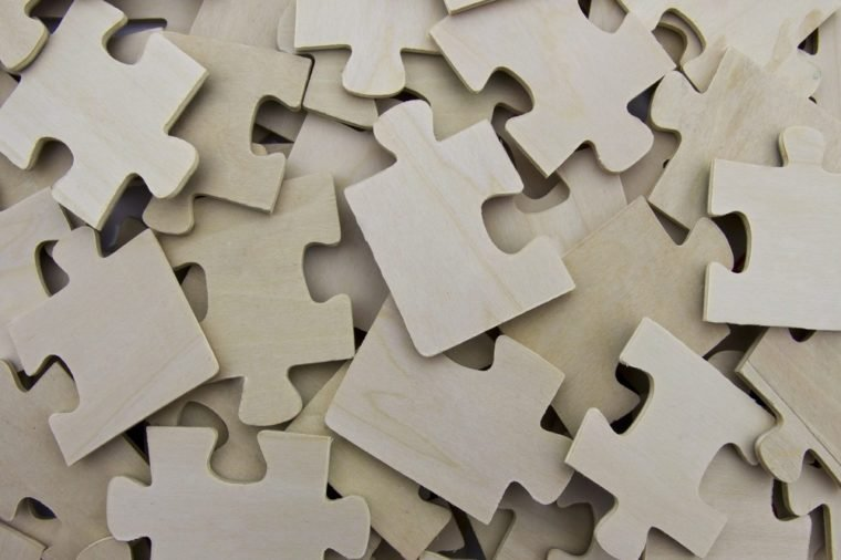 Scattered wooden puzzle pieces