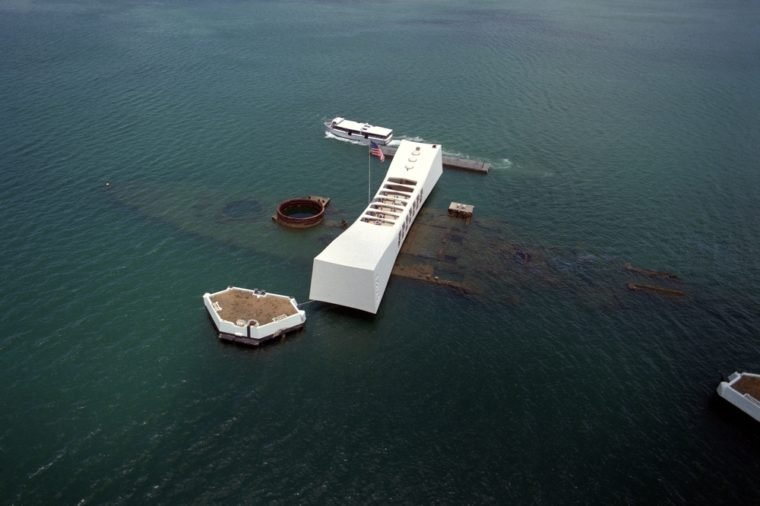 The USS ARIZONA Memorial in Pearl Harbor. The actual battleship sunk during Japanese attack on Pearl Harbor on December 7 1941 is visible directly beneath memorial. June 1 1991.