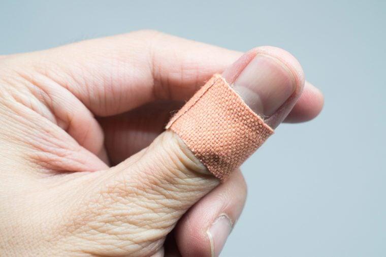 bandaid on hand isolated on white background