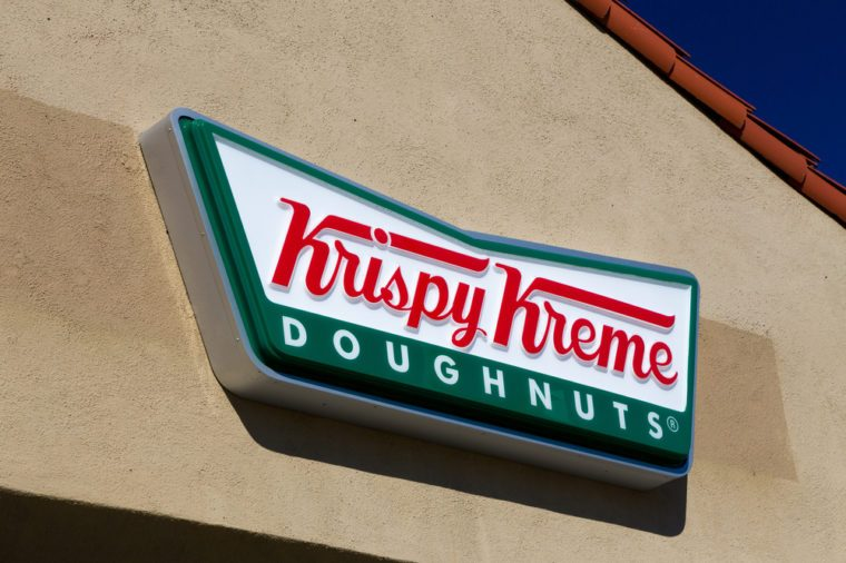 LOS ANGELES, CA/USA - November 11, 2015: Krispy Kreme Doughnuts exterior and logo. Krispy Kreme Doughnuts, Inc. is an American global doughnut company and coffeehouse chain.