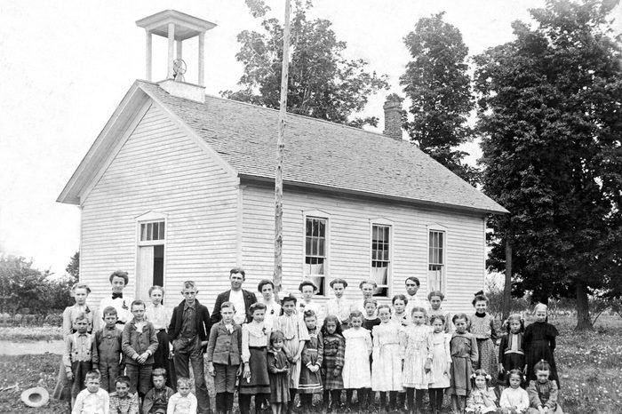 S one room school house with the children of all ages.