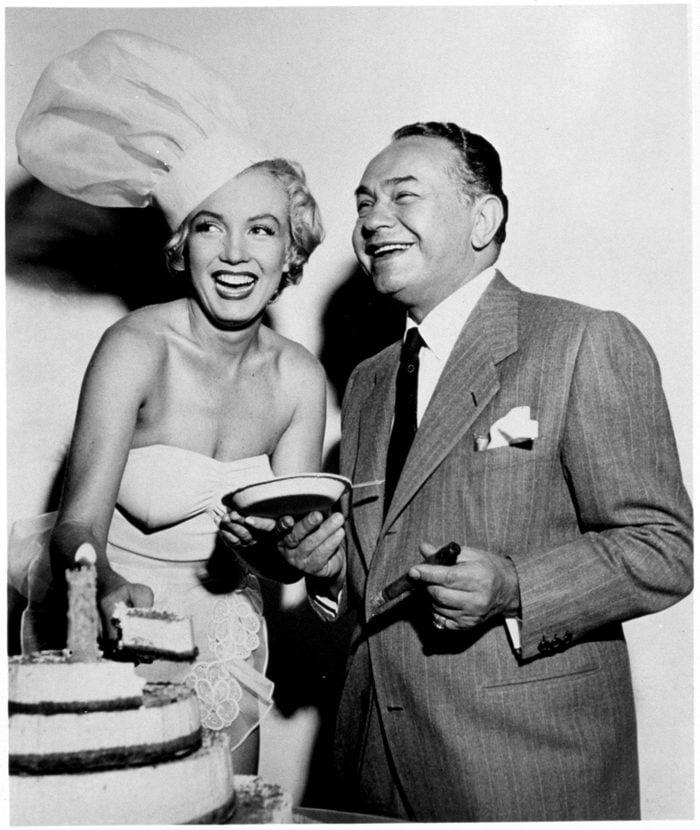 VARIOUS FILM STILLS OF 1951, MARILYN MONROE, EDWARD ROBINSON G, CHEFS HAT, LAUGHING, CLOWNING, FUN, CAKE IN 1951