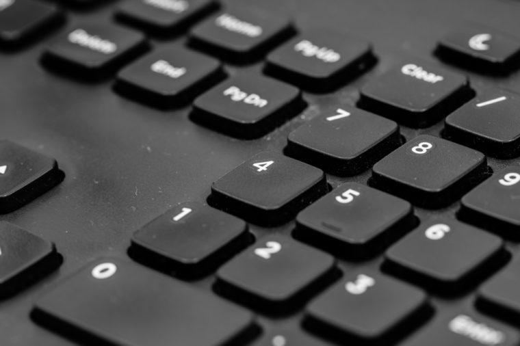 Black laptop keyboard close up