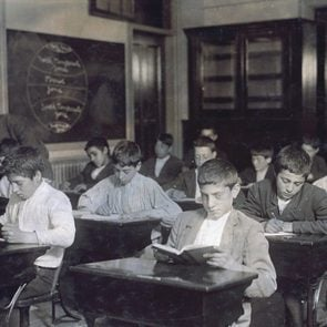 class of immigrants in a night school