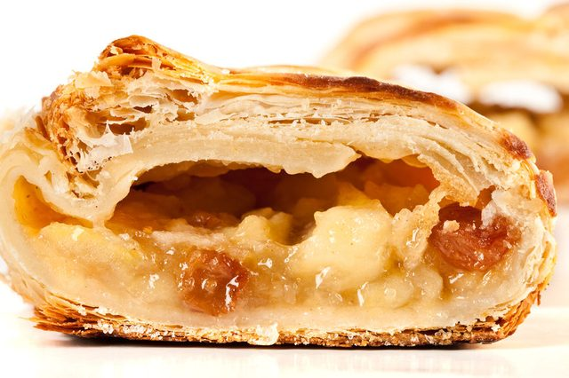 Studio close up of delicious apfelstrudel (apple pie) isolated on white background