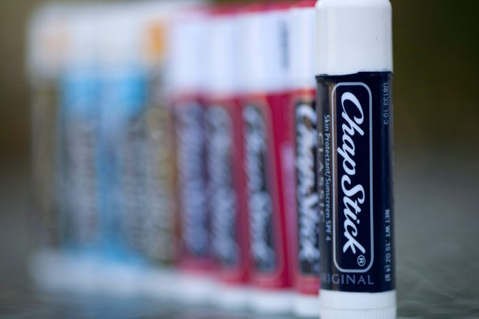 Earns Plizer, Miramar, USA Chap Stick In this Jan. 30, 2012 photo, a row of ChapStick containers is on display at a Mirmarar, Fla. drug store. Pfizer Inc. said, that its fourth-quarter profit fell by half due to one-time charges and a drop in U.S. revenue, which was hurt by blockbuster cholesterol drug Lipitor losing patent protection