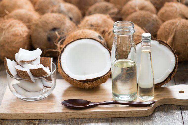 wood spoon and virgin coconut oil. Raw coconut can make virgin oil by cool process centrifuge for good fat no cholesterol . Pure Coconut oil can eat every day and wash or clean cosmetics
