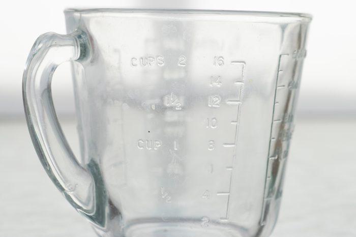 Measuring mug on a white background