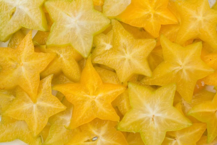 Star fruit, starfruit or star apple , Averrhoa carambola slice background