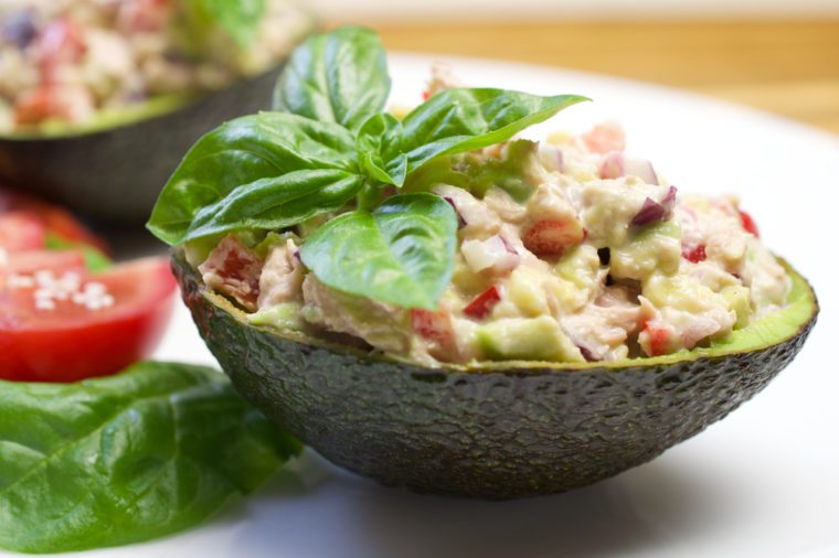Tuna stuffed avocado. Avocado tuna salad. Healthy lunch - tuna stuffed avocado. Tuna salad