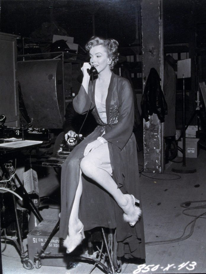 VARIOUS FILM STILLS OF 'DON'T BOTHER TO KNOCK' WITH 1952, MARILYN MONROE, MOVIE SET, TELEPHONING, STOOL, SITTING, SHOES, FUR, LEGS, LINGERIE IN 1952