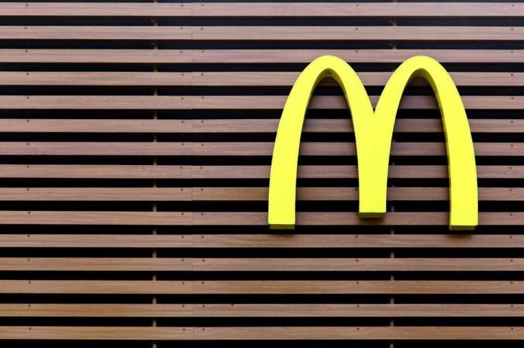 Vejle, Denmark - July 4, 2015: Mc Donald's logo on a striped facade