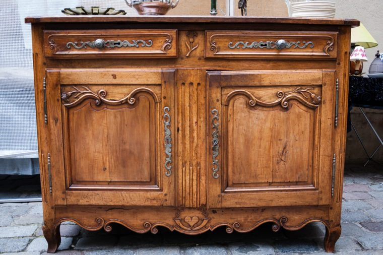 Vintage luxury dresser at flea market in Paris (France)