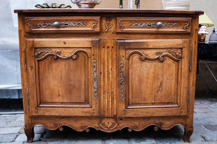 Vintage luxury dresser at flea market in Paris (France)