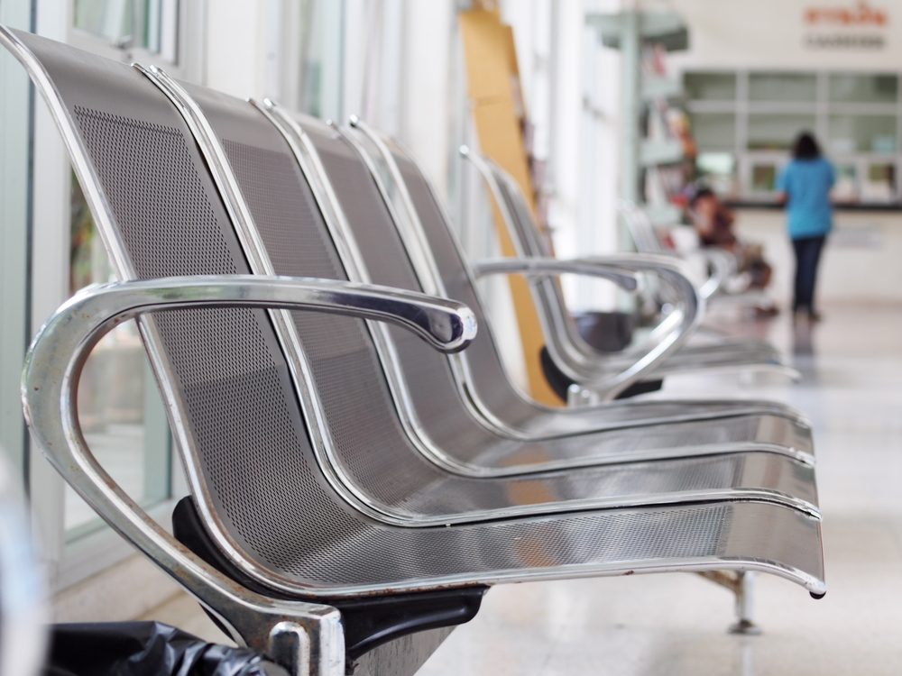 close up shallow depth of field photo of stainless steel chair installed on a balcony terrace public area for customer of a vet animal hospital as functional orientated interior furniture design