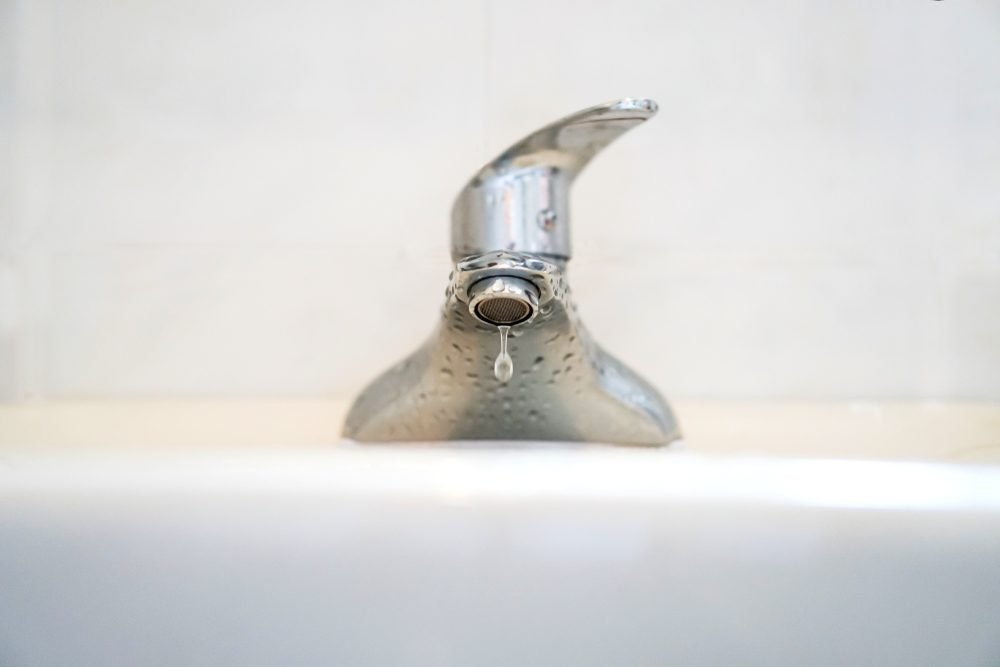 Faucet with water.Drop of water.