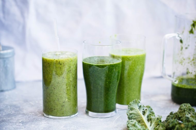 Green smoothies glass with green fruits and vegetables. Green smoothie glass. Copy space. Detox, dieting, clean eating, fitness diet concept.