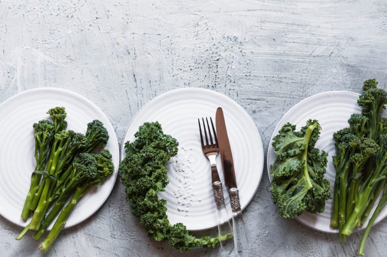 Green salad concept kale leaves broccolini healthy dieting food concept light grey style