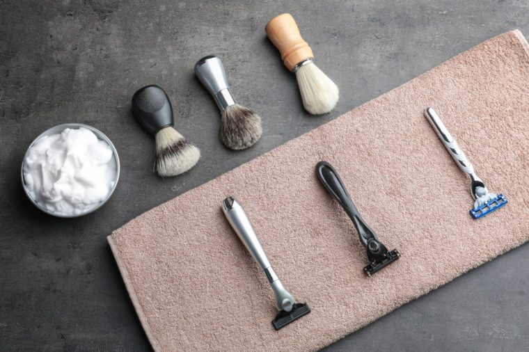 Shaving accessories for man on grey background
