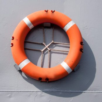 An orange safety ring float hanged