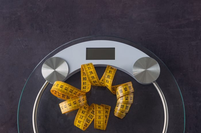 Weight scale and a measuring tape. Concept- lifestyle, sports and diet for weight loss. Copy space.